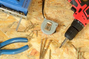 Set of tools - jigsaw, drill, pliers, screws