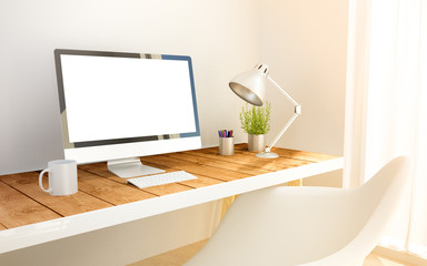 minimalist workplace with blank screen computer