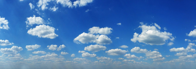 White heap clouds in the blue sky at summer day.