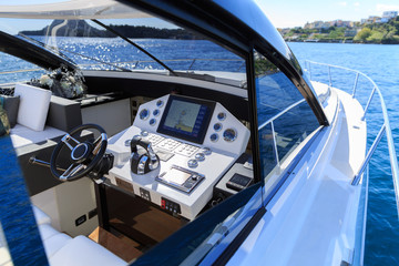 Steering boat of luxury motoryacht at sunset