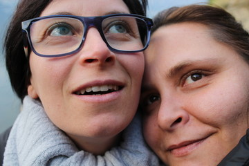 faces of two women, sisters in the foreground