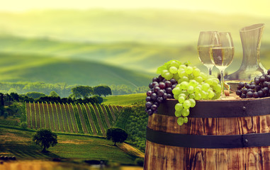 Wall Mural - White wine bottle and wine glass on wodden barrel. Beautiful Tus