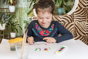 Cute young girl painting a picture