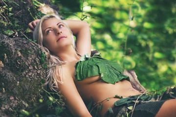 Beautiful sexy women resting in the deep fabulous forest.