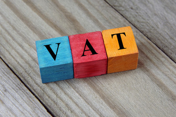 VAT text (Value Added Tax) on colorful wooden cubes