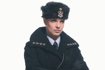 Female guard wearing retro russian winter costume with hat isola