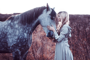 beauty blondie with horse in the field,  effect of toning
