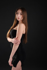Beautiful elegant slim girl in black short dress
