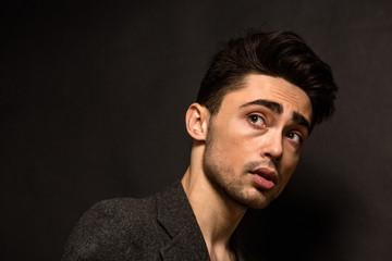 Portrait of model man's face in studio