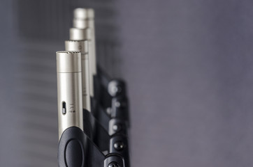 Condenser microphones placed in microphone stands in a lab of so