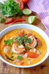 Tom Yum Kung or Tom Yam Koong is a Thai spicy soup with Shrimps and fresh herbs.