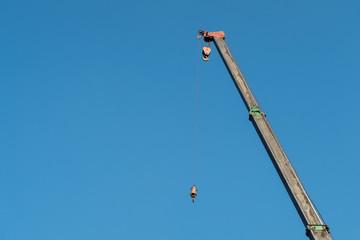 Fototapeta yellow crane with blue sky background obraz