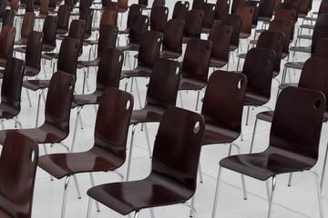 Fototapeta empty chairs in a row obraz