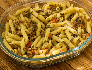 Fototapeta Minced meat with pasta onions and sweet peppers. Warm color balance. obraz