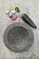Fototapeta Stone mortar with many kind of herbs in kitchen obraz