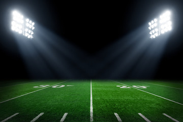 Football field illuminated by stadium lights
