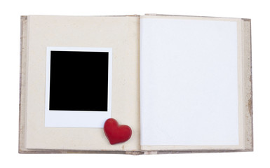 Photo album with frame and red heart