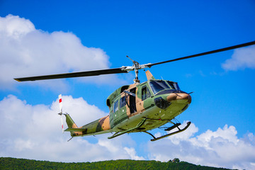 Wall Murals Helicopter close up military helicopter on the sky