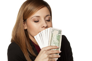 happy business woman enjoying the smell of money