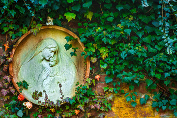 Mother Mary and Jesus Born Christianity Religion in Cemetery Graveyard in Nature
