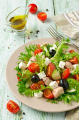 Fresh salad with tuna, tomatoes and cucumbers