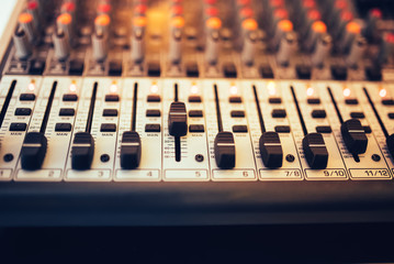 Detail of a music mixer in studio, dj working for new tracks. Music production with editing tools..