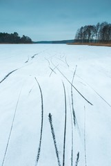 Frozen lake with skates traces