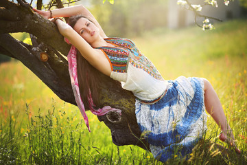 Romantic hippie posing in spring meadow