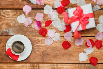 Valentines Day gift and coffee  on wooden background