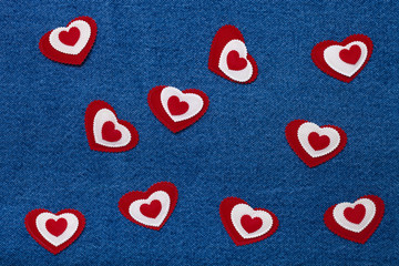 Textile hearts. Romantic love theme on jeans background