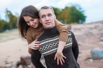 Loving couple hugging on the rocky beach