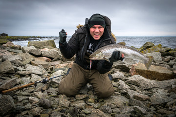 Happy man with big sea trout trophy