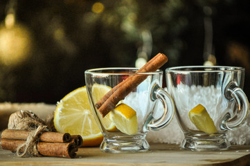 empty glass cups with lemon and cinnamon