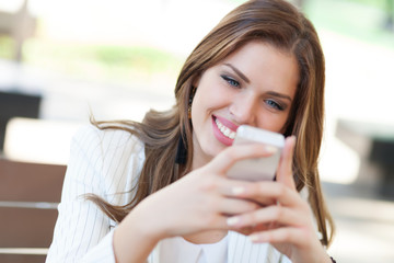 Portrait of a young woman using a cellphone