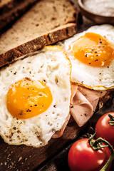 Tasty eggs, ham and tomato breakfast