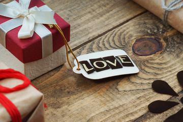 Gift boxes and label with word Love