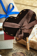 Gift box and heart shapes on a table
