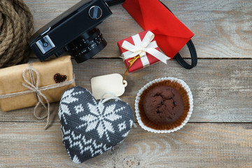 Gift boxes, muffin, photo camera and heart shapes