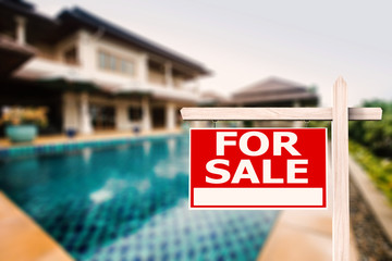 for sale sign with luxury house background
