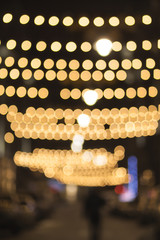 Blurred background night photo. Cityscape bokeh. Defocused abstract city. Background out of focus. Fairy defocused photo.