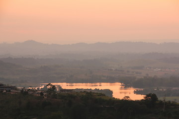 Rattanai reservoir with the light of sunset in the evening at Phetchabun province, Thailand