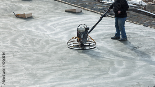 Construction worker produces the grout and finish wet