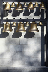 Various bells in a row