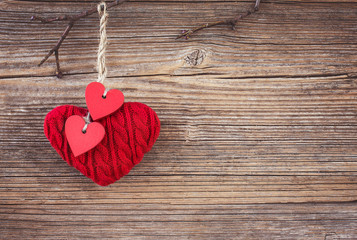 Valentines day red hearts over wooden background. Toned, soft focus, copy space