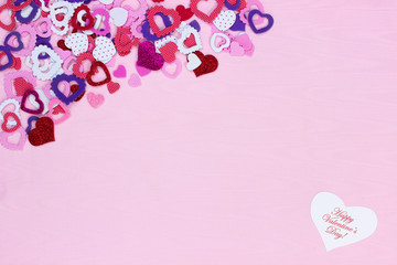Blank pink sign with collection of colorful hearts and Happy Valentine's Day