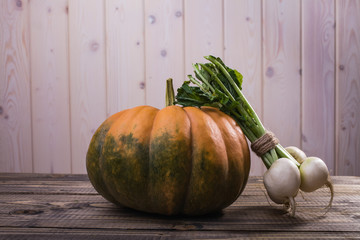 Still life of pumpkin and turnips