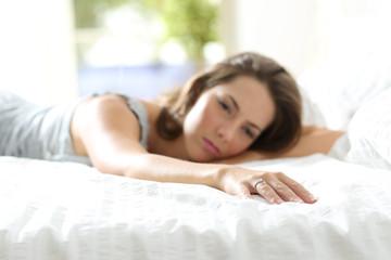 Sad girlfriend missing her boyfriend on the bed