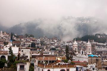 Hazy Taxco houses and Church