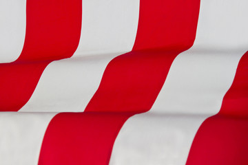 Red striped fabric waving background
