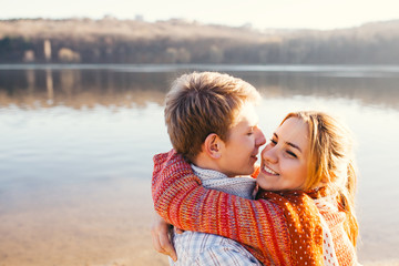 Young couple in love outdoor at a lake